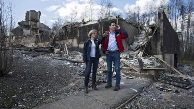 Alberta Premier Rachel Notley and Canadian Prime Minister Justin Trudeau inspect wildfire damage in Fort McMurray, Alberta, 13 May 2016
