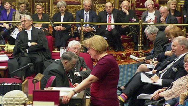 Theresa May watches the debate