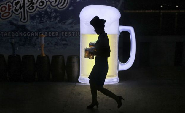 Woman carrying beer at Pyongyang festival
