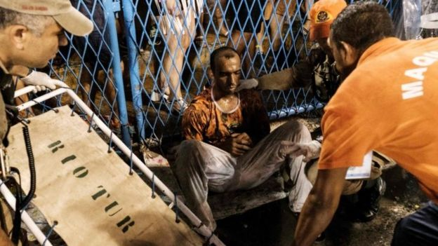 A man hurt by a float of the Paraiso do Tuiuti samba school during the first night of Rio's Carnival is assisted at the entrance of the Sambadrome in Rio de Janeiro, Brazil, on February 26, 2017.