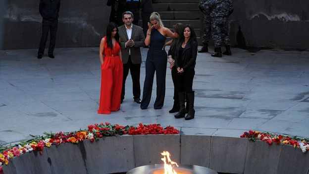 US reality TV star Kim Kardashian (L) and her sister Khloe (3rdL) visit the genocide memorial, which commemorates the 1915 mass killing of Armenians in the Ottoman Empire, in Yerevan