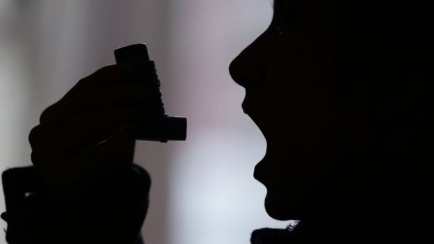 File image of person using an inhaler