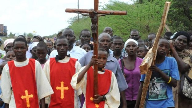 Catholic Church faithfuls take part in a procession, to re-enact the crucifixion of Jesus Christ, on April 3, 2015 in Machakos, during the Holy Week celebrations