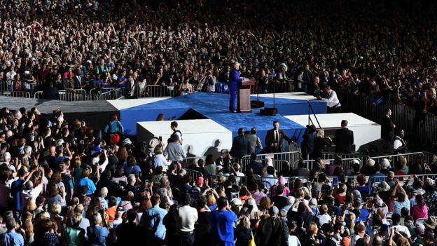 Hillary Clinton on stage at a rally