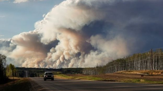 Smoke billows from the Fort McMurray wildfire. Photo: 5 May 2016