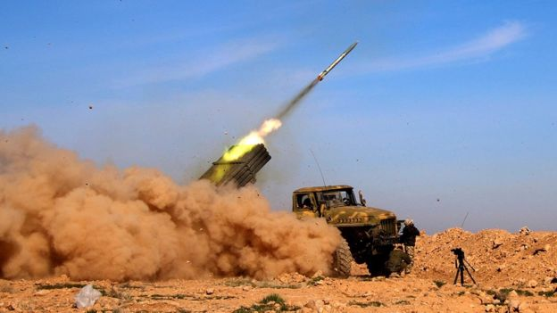 Syrian army fires a rocket at Islamic State group positions in the province of Raqqa, Syria (17 February 2016)