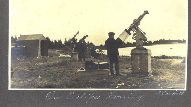 Family photos show preparations for observing an eclipse