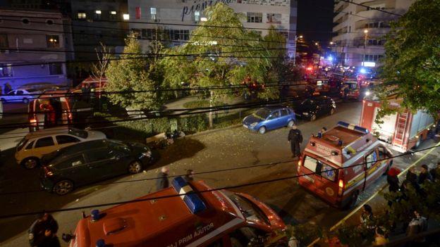 Emergency services work outside a nightclub in Bucharest, Romania