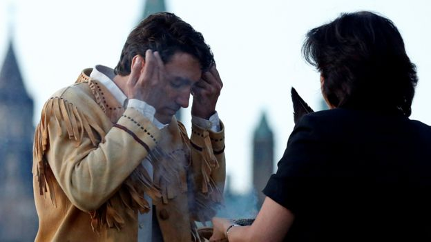 Canada's Prime Minister Justin Trudeau takes part in a smudging ceremony during the National Aboriginal Day Sunrise Ceremony in Gatineau, Quebec, Canada, June 21, 2016