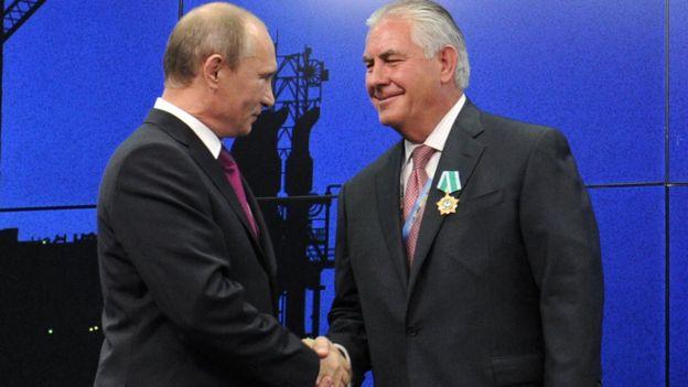Vladimir Putin y Rex Tillerson