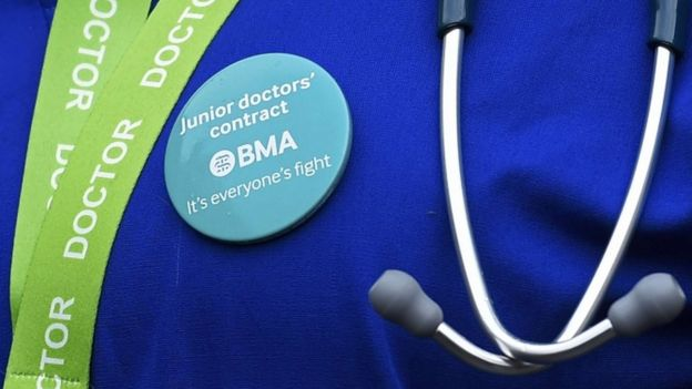 Junior doctor wearing a protest badge
