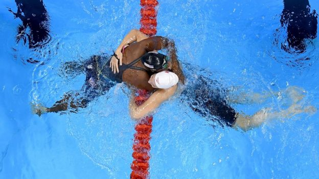 Swimmer Simone Manuel of the United States (L) embraces Penny Oleksiak of Canada after both winning gold