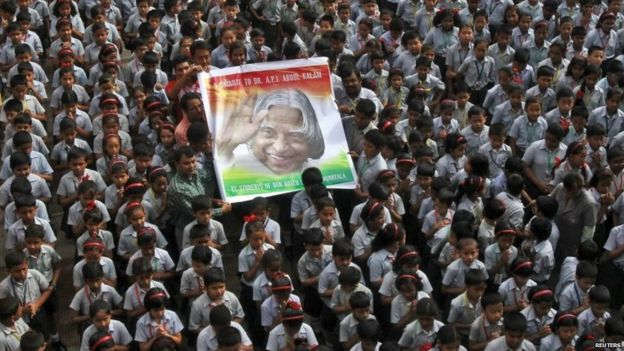 Teachers and schoolchildren hold a portrait of the former Indian President A. P. J. Abdul Kalam during a prayer ceremony in Agartala, India, July 29, 2015