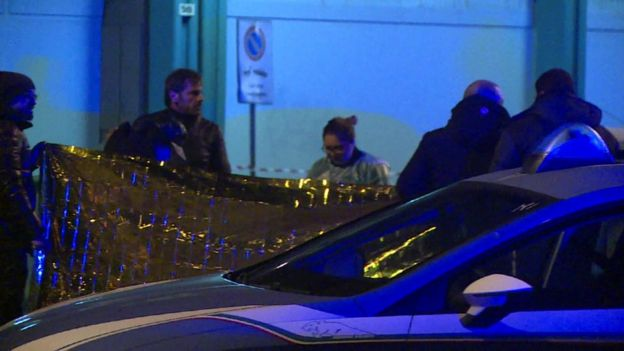 Police and forensics at the scene of a shootout in Milan