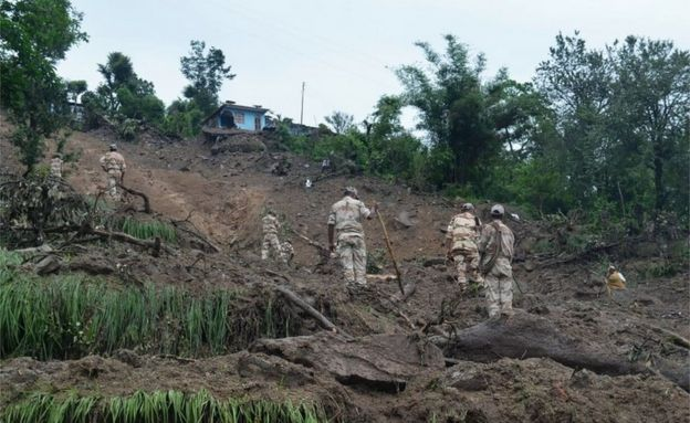 This handout photograph released on July 2, 2016 by the Indian Army shows Indian soldiers searching for survivors of a landslide following torrential rains in the Pithoragarh area of rural Uttarakhand state.