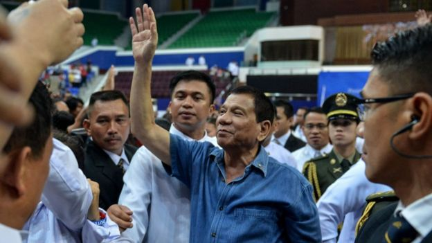 Philippine president Rodrigo Duterte waves to the crowds