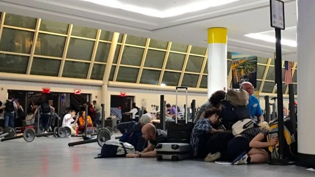 Frightened passengers cowered while police searched the terminals at JFK airport on 15 August