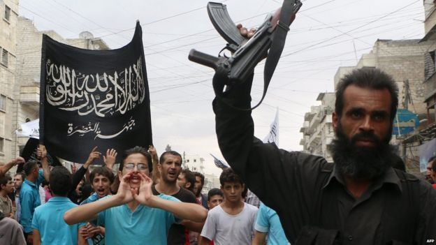 Supporters of al-Nusra Front protest against US missile strikes on so-called Khorasan Group militants in Syria (26 September 2014)