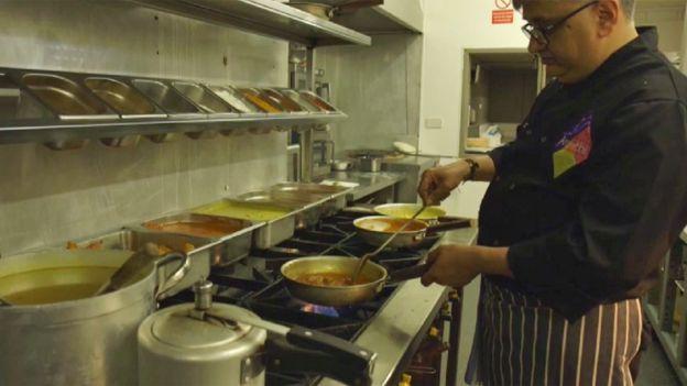 Cook preparing Indian food