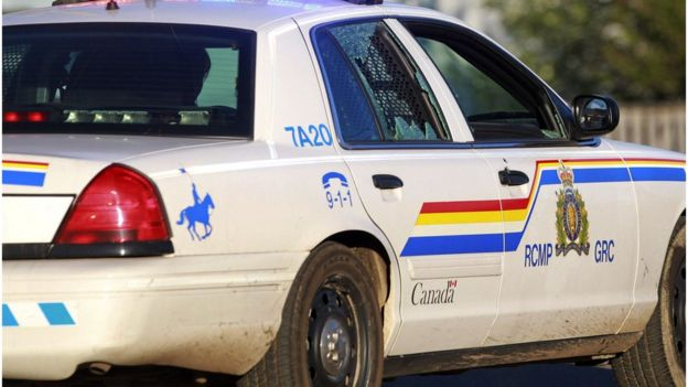 A Codiac RCMP officer drives on with her rear passenger window shattered in Moncton, New Brunswick June 4, 2014.