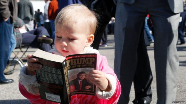 Child reads Art of the Deal