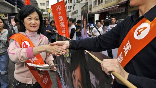 Hong Kong's former security secretary Regina Ip (L) canvasses for last minute votes for the territory's legislative by-elections in Hong Kong, 02 December 2007