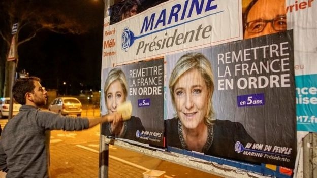 Marine Le Pen's posters are put on in Lyon. File photo