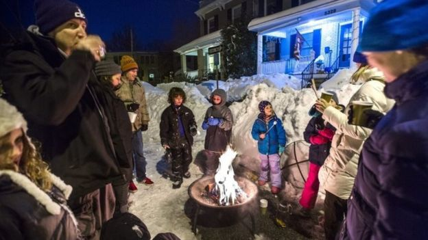 Residents of Belt Road make the best of the snowstorm with a post-blizzard bonfire, complete with roasted marshmallows and mulled wine (24 January 2016)