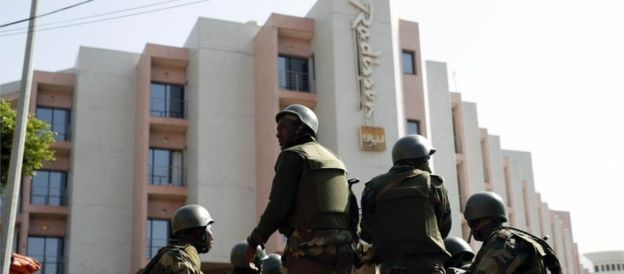Soldiers from the presidential patrol outside the Radisson Blu hotel in Bamako, Mali, Saturday, Nov. 21, 2015
