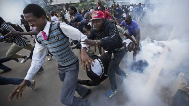 Opposition supporters flee from tear gas grenades fired by riot police, during a protest in downtown Nairobi, Kenya Monday, May 16, 201