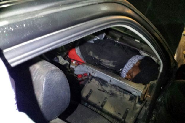 African migrant hiding in car dashboard, 2 Jan 17 (Spanish Civil Guard photo)