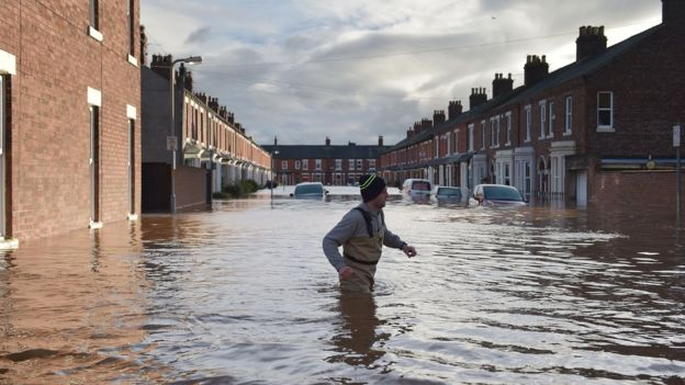 Hundreds of homes have been flooded and more than 1,000 people evacuated in Cumbria and the Scottish Borders
