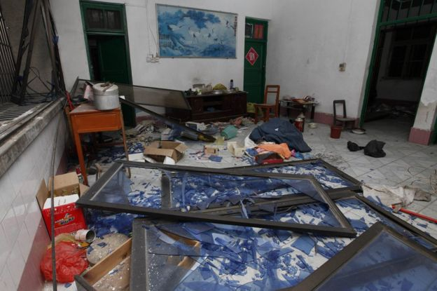 Damaged windows are seen on the ground of a room at the site of blasts in Liucheng county in Liuzhou in south China