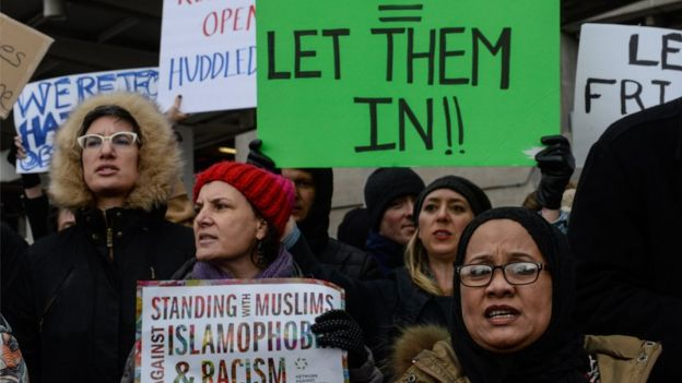 Protesters rally during a protest against the Muslim immigration ban at John F. Kennedy International Airport on January 28, 2017 in New York City