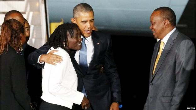President Barack Obama (centre) hugs his half-sister Auma