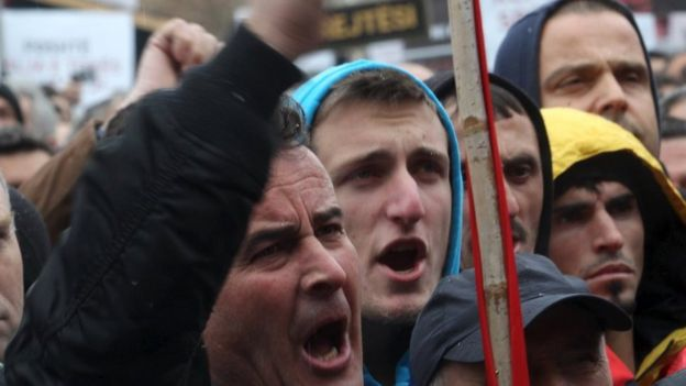 A man waves his fist during the protest
