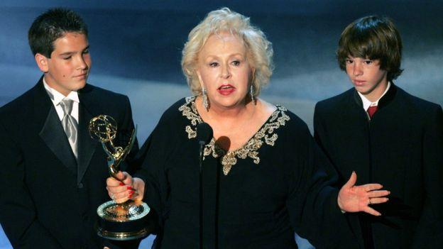 Doris Roberts accepting an Emmy award alongside her grandsons
