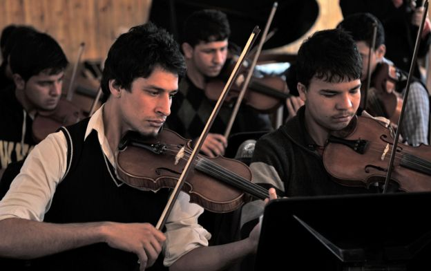 Afghan youths playing the violin at Afghanistan's National Institute for Music in Kabul, 2012