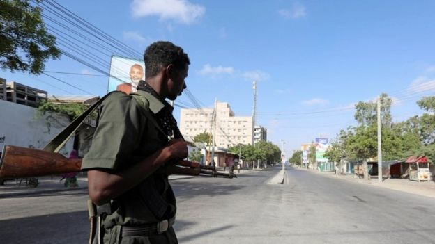 Somali policeman stands guard along a road which was blocked to control motor vehicle traffic, during a security lock down in Somalia's capital Mogadishu, February 7, 2017.
