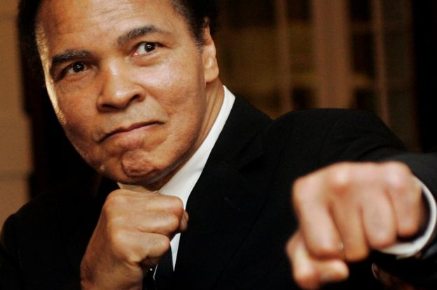 U.S. boxing great Muhammad Ali poses during the Crystal Award ceremony at the World Economic Forum (WEF) in Davos, Switzerland January 28, 2006.