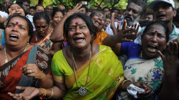 Indian supporters of the Chief Minister of Tamil Nadu Jayalalitha react outside the hospital after false reports that she had died in Chennai