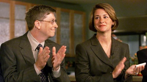 Bill Gates looks at his wife Melinda during a press conference in Seattle in 1999