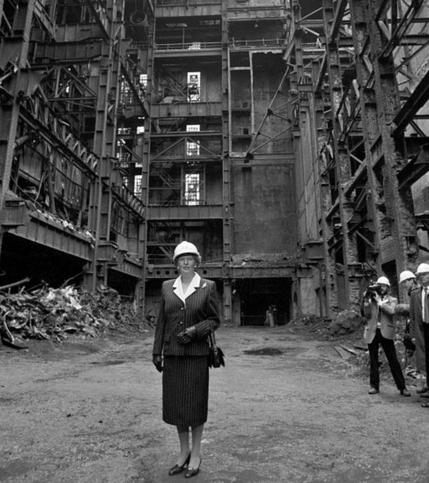 margaret thatcher stands in the shell of battersea power station in 1988 apple head office london