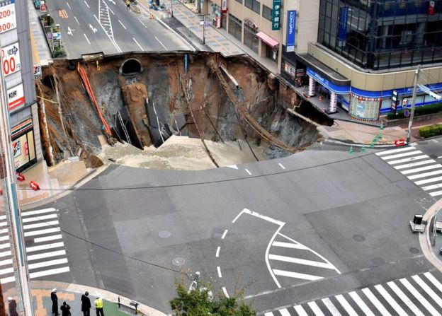 Aerial view of sinkhole (source: KYODO/REUTERS)