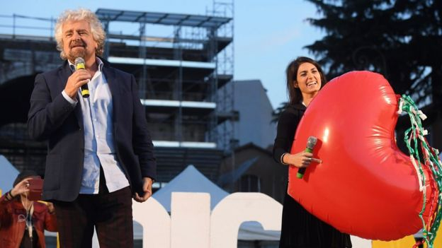 Five Star Movement leader Beppe Grillo, left, with Rome Mayor Virginia Raggi on 26 Nov