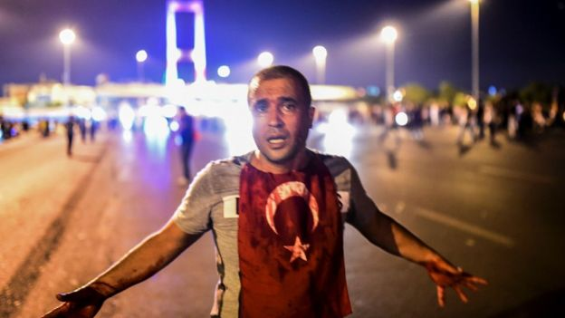 Man covered with blood near the Bosphorus bridge in Istanbul on 16 July 2016