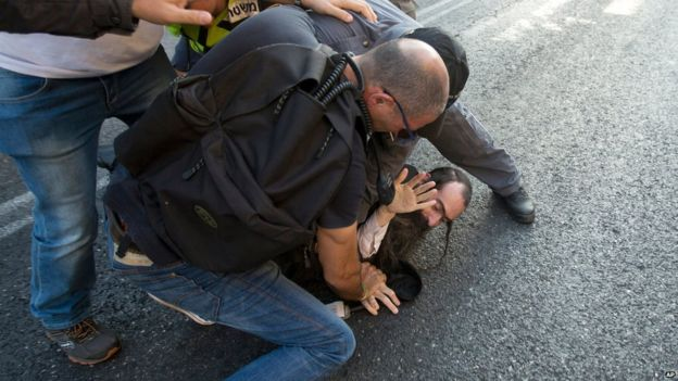 Police arrest an ultra-Orthodox Jew after he attacked people with a knife during a Gay Pride parade Thursday, July 30, 2015