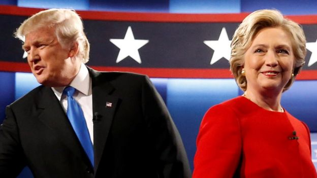 Republican U.S. presidential nominee Donald Trump and Democratic U.S. presidential nominee Hillary Clinton greet one another as they take the stage for their first debate at Hofstra University in Hempstead, New York on 26 September 2016