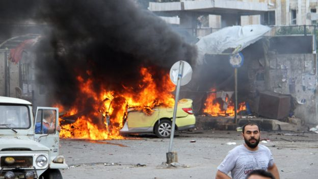 Syria conflict: Deadly blasts rock Assad strongholds