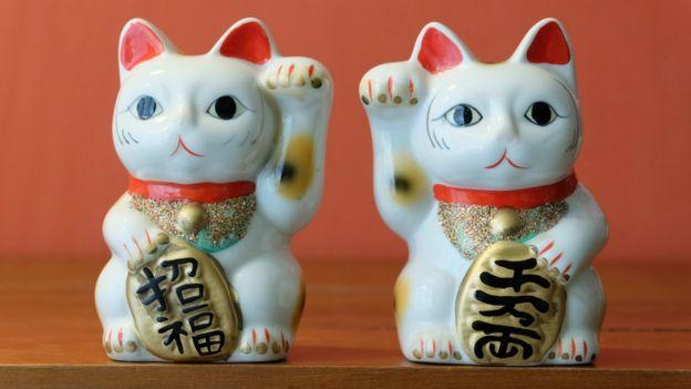 Two maneki-neko 'lucky cats'